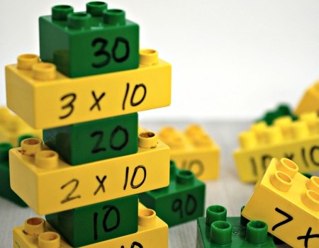 Counting by Tens with Legos - Teach your child how to count by 10s, multiply by 10s and all through play with this hands-on learning activity for math.   www.joyinthehome.com